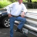 Grandpa in trucking gear aside white truck (2)